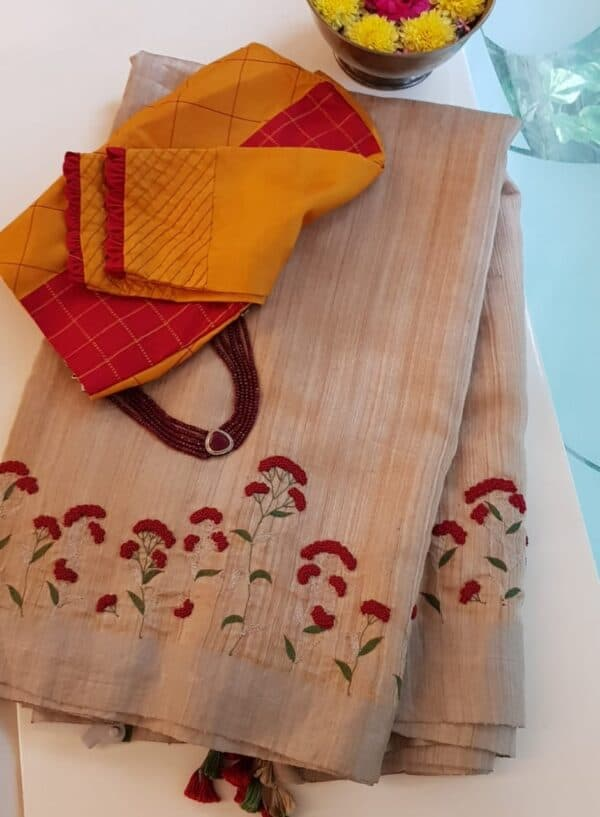 beige and red embroidered tussar saree