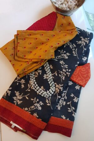 black and beige tussar saree with red and orange kutch work border