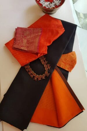 black with orange pallu