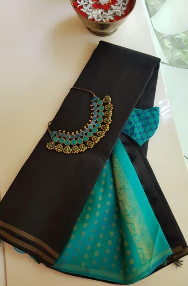 black with teal pallu