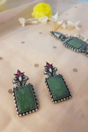 green carved earring