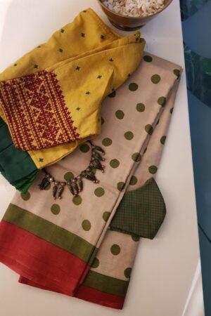 green polka dots saree
