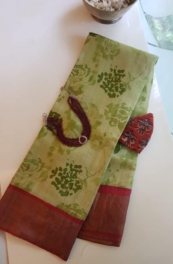 green with red border zari tussar saree