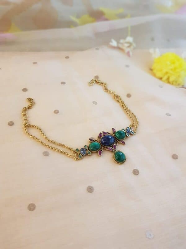 long chain with blue green pendant