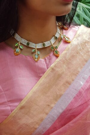 pearl choker with green stones