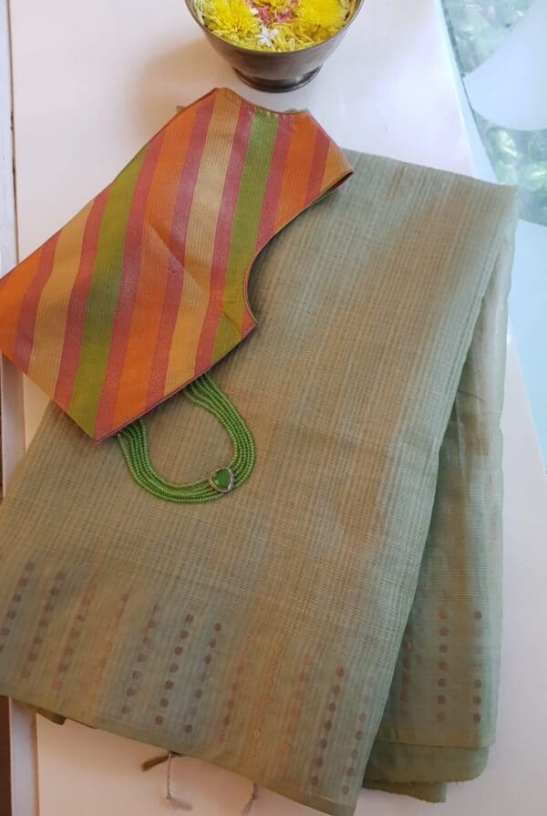 russian green organza saree with sequins woven border