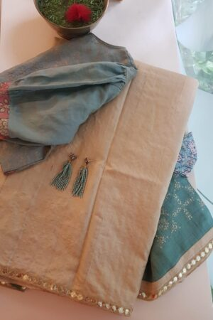 Beige tussar saree with teal pallu