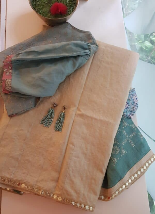 Beige tussar saree with teal pallu