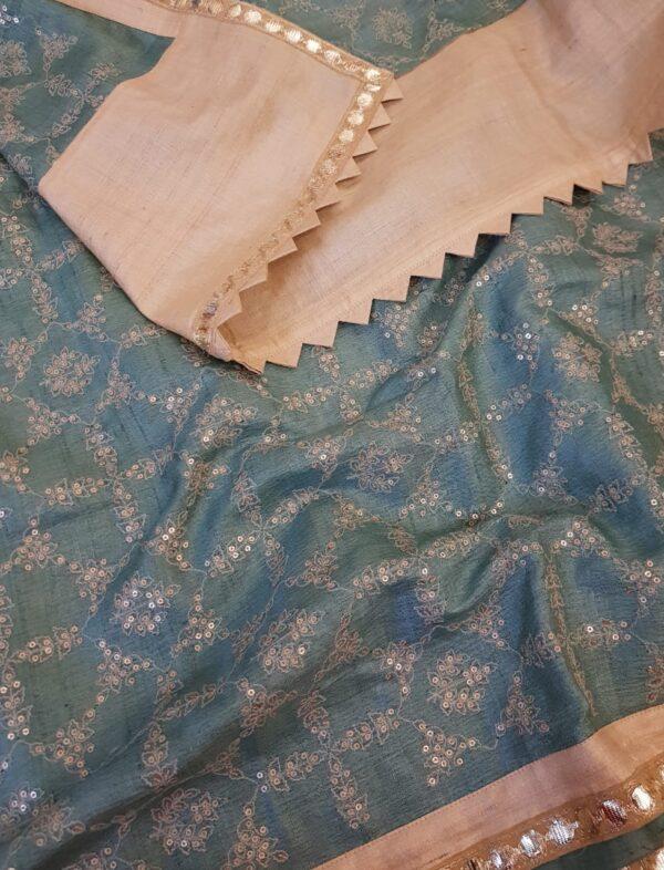Beige tussar saree with teal pallu1