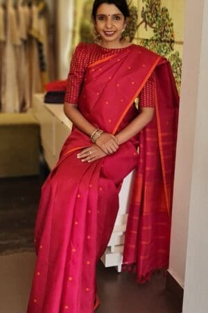 Red with burnt orange butta saree