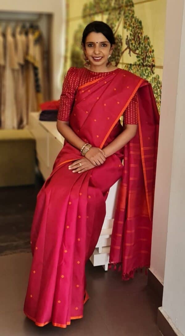 Red with burnt orange butta saree
