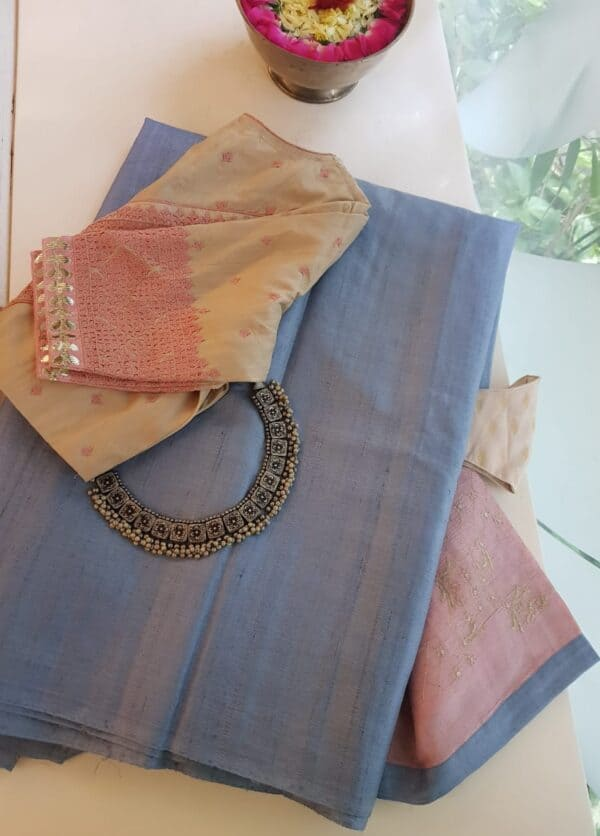 blue tussar saree with pale pink pallu