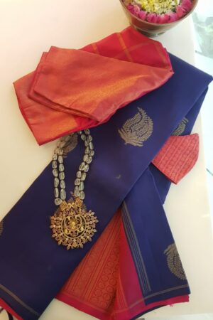 navy blue kanchipuram silk saree with pink pallu