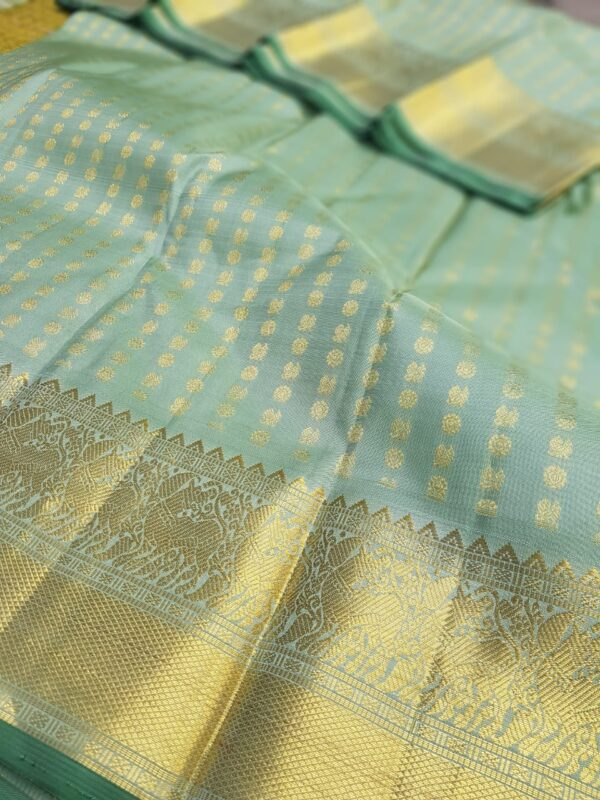 pale green silk with mayil chakram