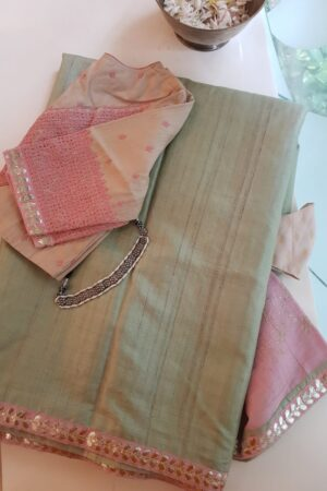 pale green with pink pallu