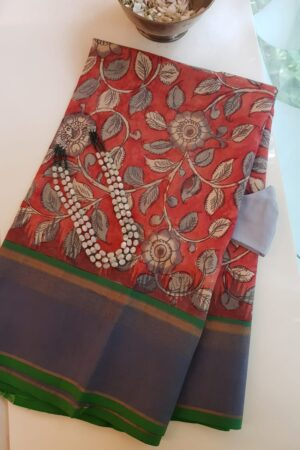 red kalamkari saree with blue border