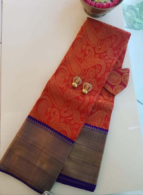 red kanchi silk saree with blue border