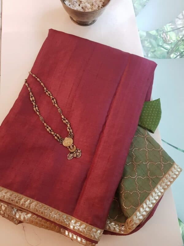 red with green pallu