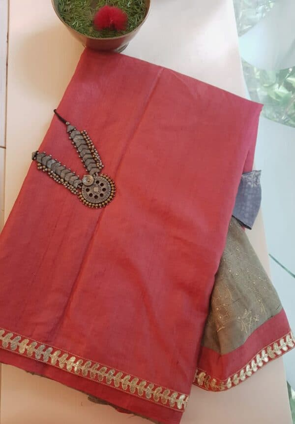 tomato red tussar saree with grey pallu