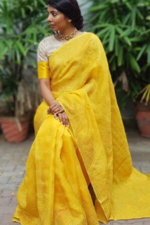 yellow organza saree with kutchwork