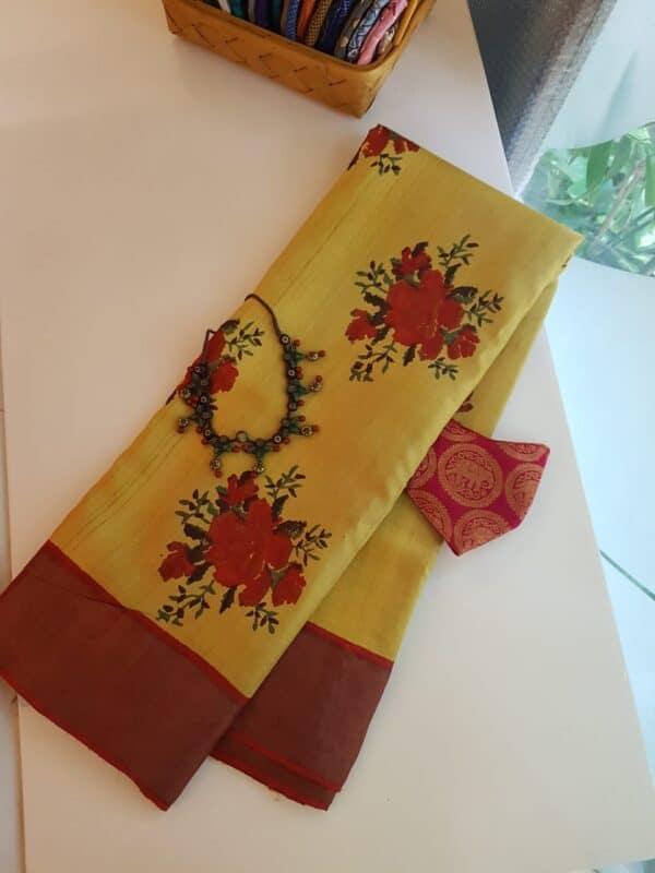 yellow with red zari border tussar sareee