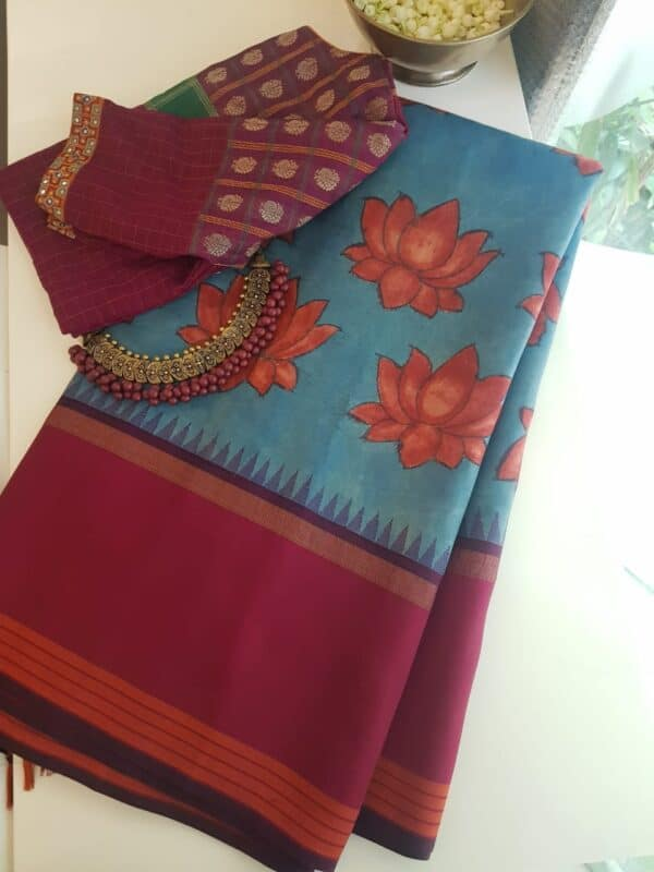 Blue with maroon border and lotus