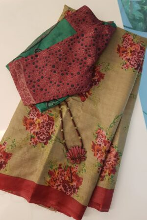 Green tussar saree with rust flowers