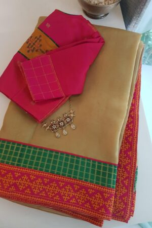 Pale mustard organza saree with kutch work border