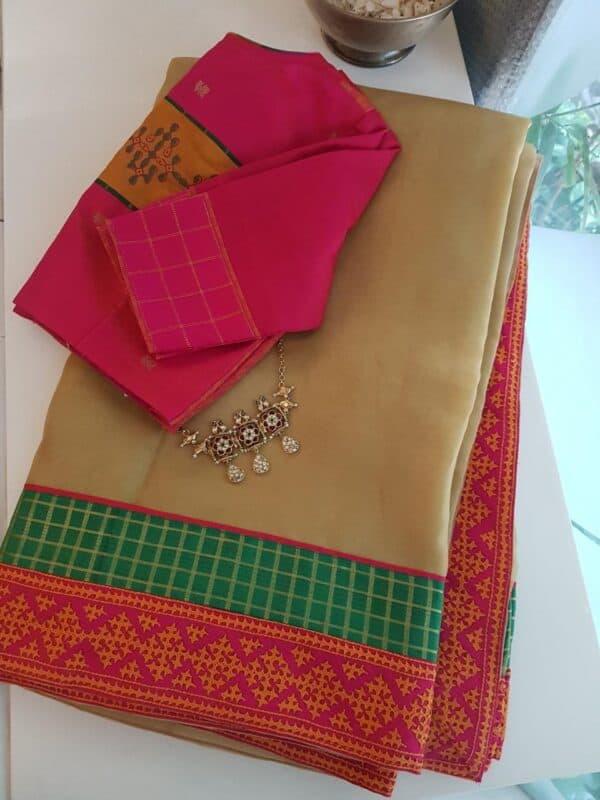 Pale mustard organza saree with kutch work border
