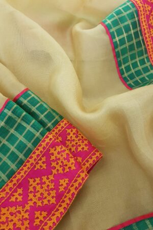 Pale mustard organza saree with kutch work border2