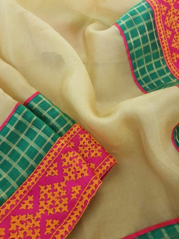 Pale mustard organza saree with kutch work border2