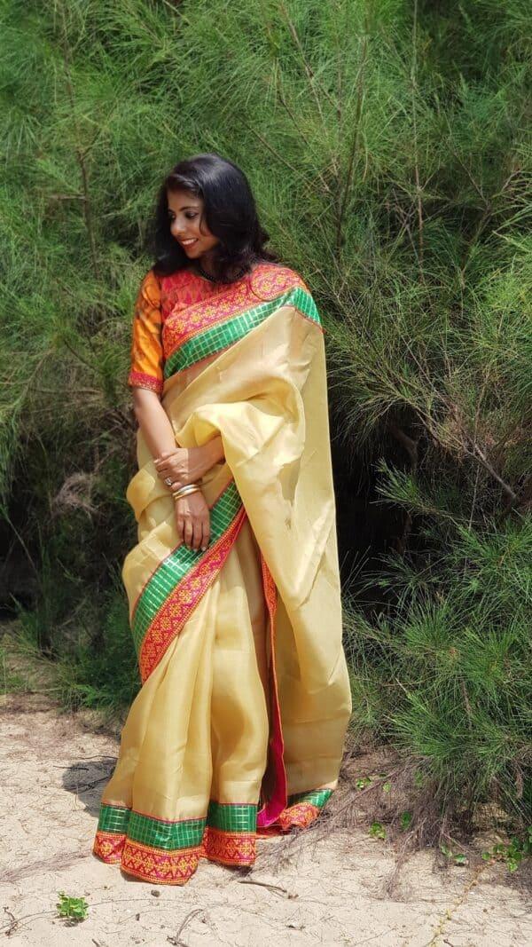 Pale mustard organza saree with kutch work border3