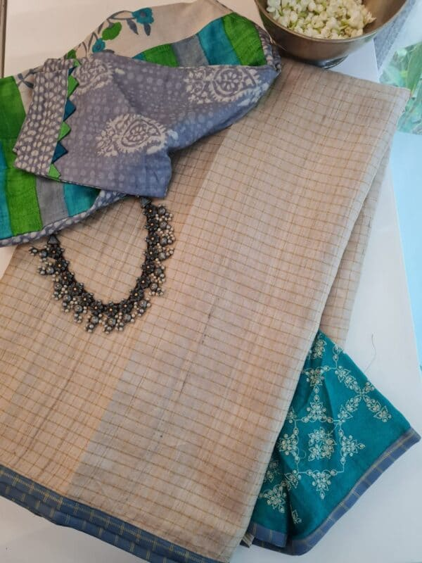 beige zari checks with teal green pallu