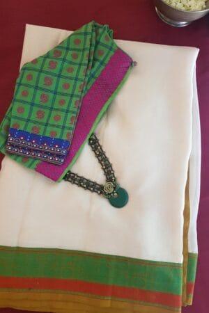 cream chiffon saree with green and rust border