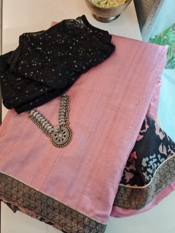 pale rose with black pallu
