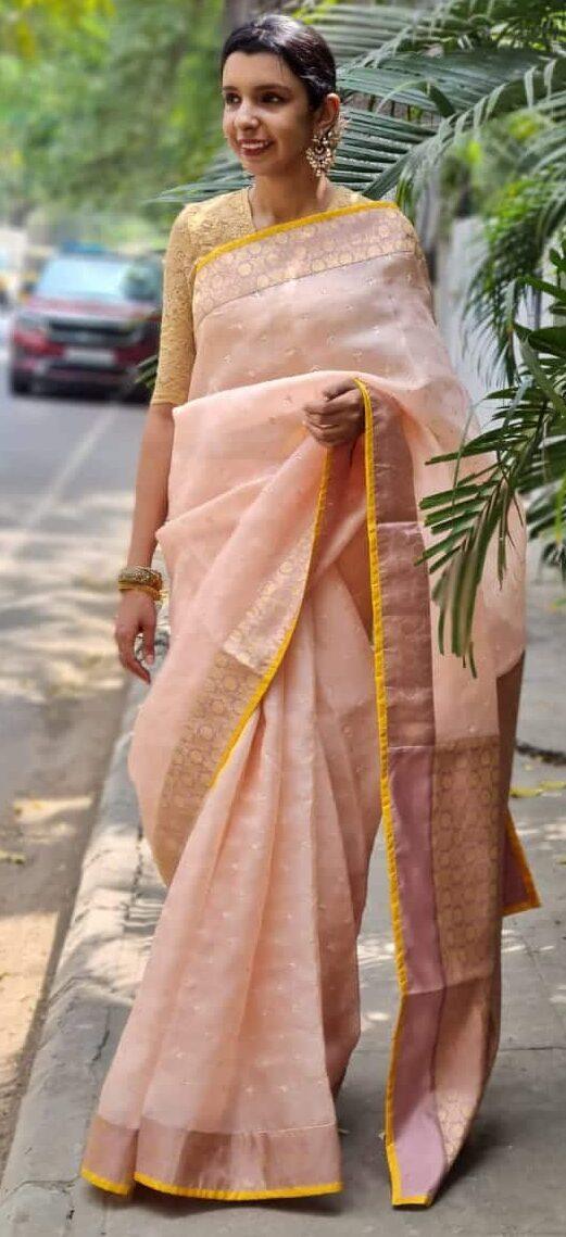 peach organza saree with kutch work and silk border and pallu
