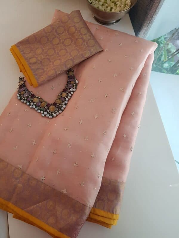 peach organza saree with kutch work and silk border and pallu1