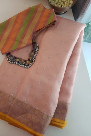 peach organza saree with kutch work and silk border and pallu2