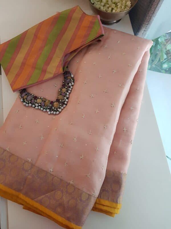 peach organza saree with kutch work and silk border and pallu2