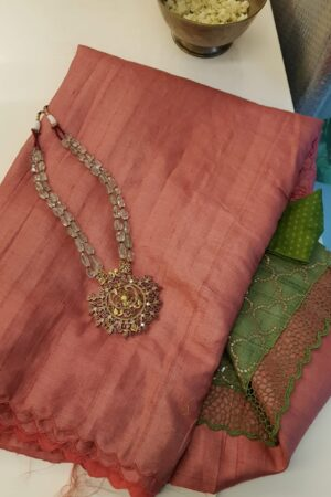 tomato pink with green pallu