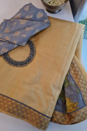 yellow with grey pallu
