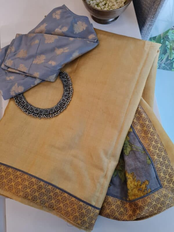 yellow with grey pallu