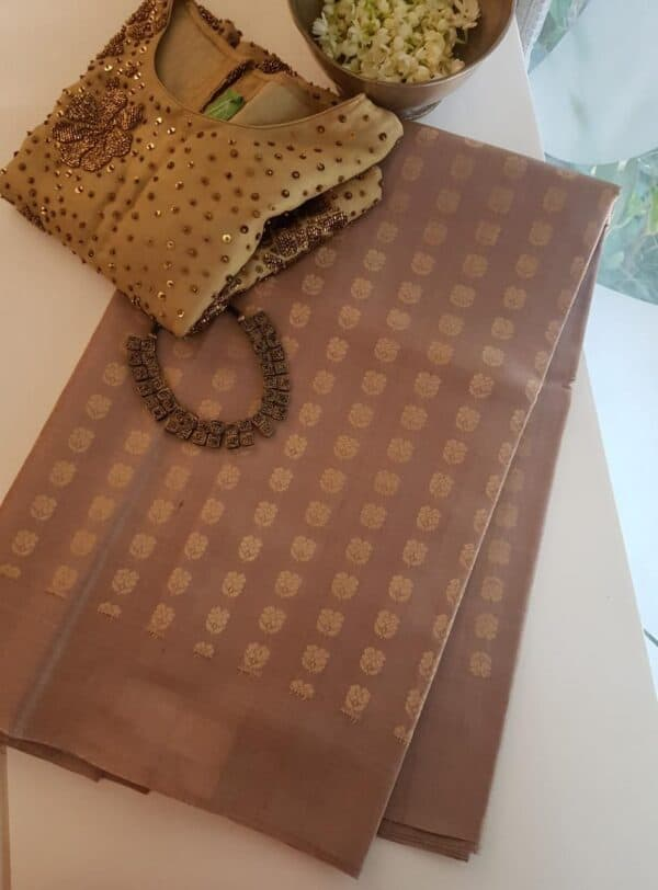 Dark beige tussar saree with floral buttons