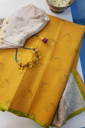 Golden yellow organza saree with tussar kutch work pallu