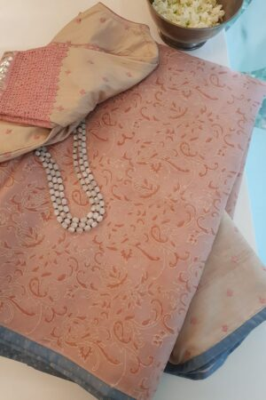 Peach organza saree with kutch work tussar pallu
