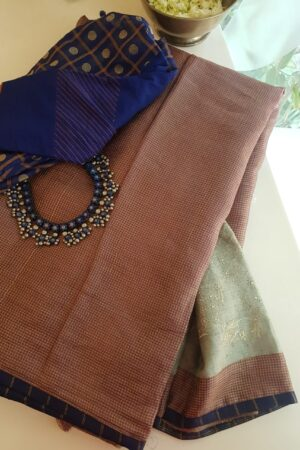 aubergine with greenish grey pallu