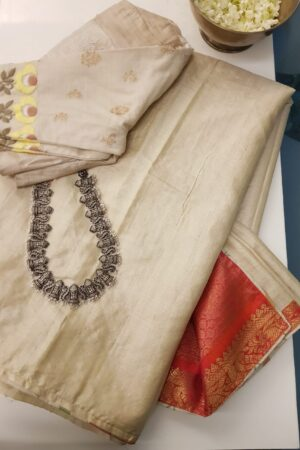 beige with red silk pallu