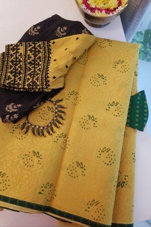golden yellow organza saree with kutch work and block print