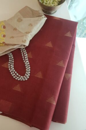 maroon tussar saree with temple motifs