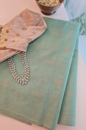 pale green tussar saree with temple motifs